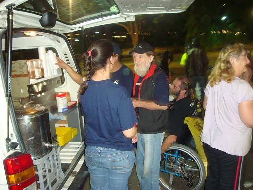 Jesus Cares volunteers serving food