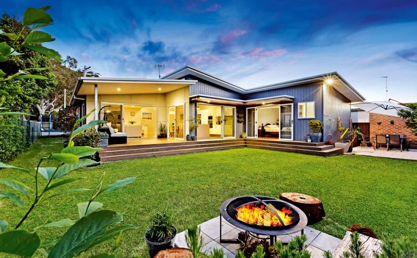 modern home with green yard