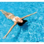 woman lying in pool