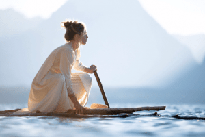 Woman silent paddle boarding, relax, ocean, mountains, travel
