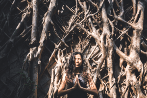 woman yoga forest prayer meditation