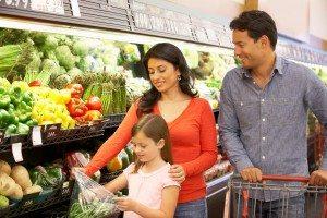 happy family shopping vegeatables at supermarket