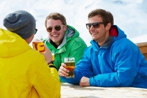 group of young men enjoying a beer on a cold winter day