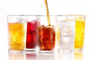 Soft drinks with ice being poured