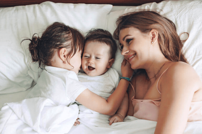 Young family hugging mother happy children kids intuition parenting