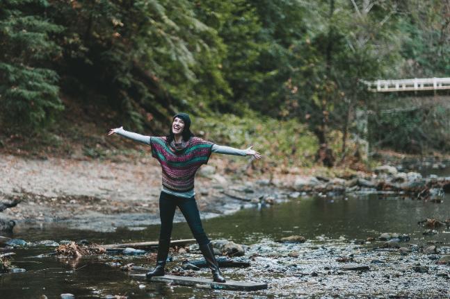 Happy woman in stream