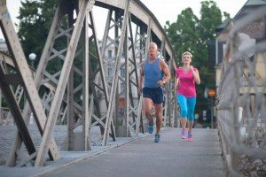 healthy mature couple jogging in the city