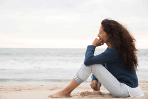 woman thinking pondering looking ocean meditate