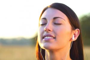 woman headphones listen sound phone technology bliss meditate