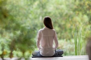 Seated woman meditating