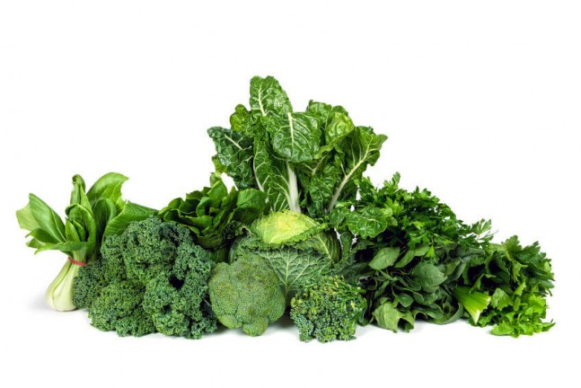 leafy green vegetables against a white background