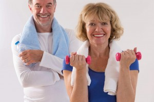 elderly ccouple exercising with weights