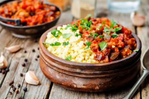 buttered millet with tomato eggplant curry