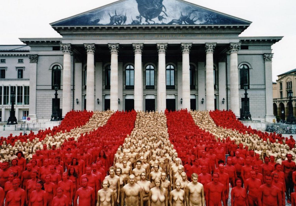 Volunteers pose naked outside Munich's Bavarian State Opera for a Spencer Tunick photograph.