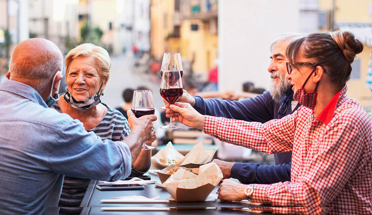 Group old people eating drinking outdoors