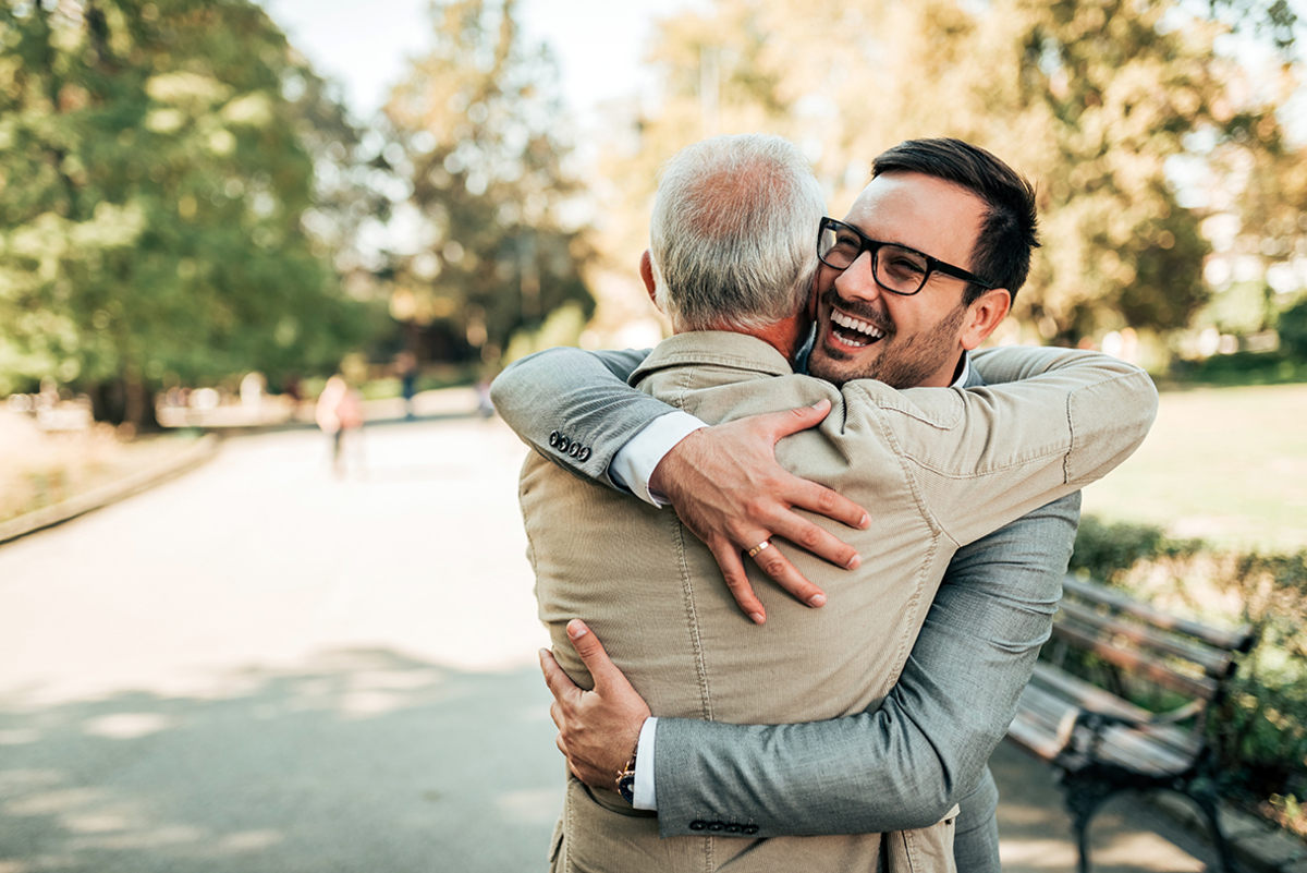 Family reunion father son hugging outdoors