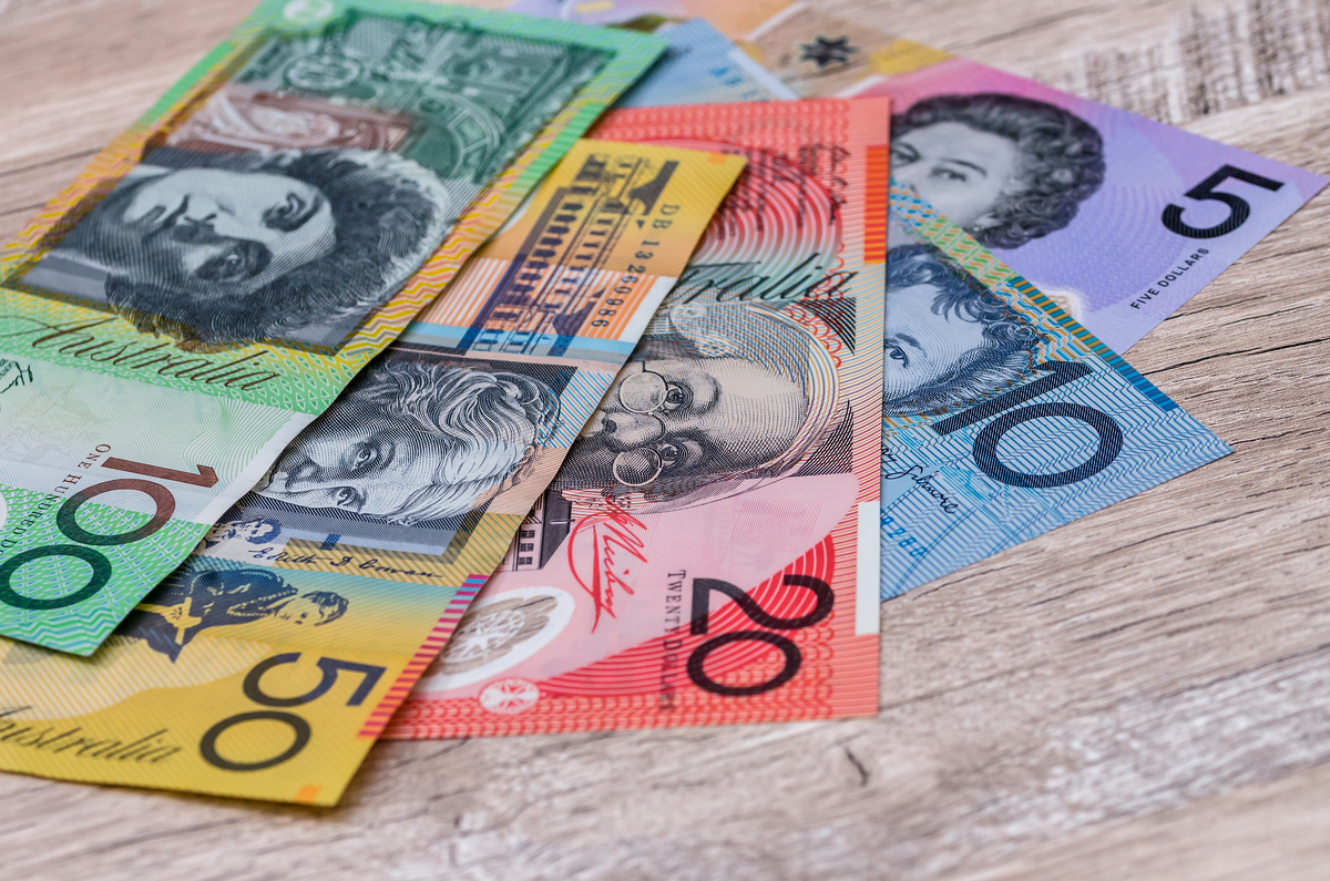 Australian dollar banknotes wooden table background
