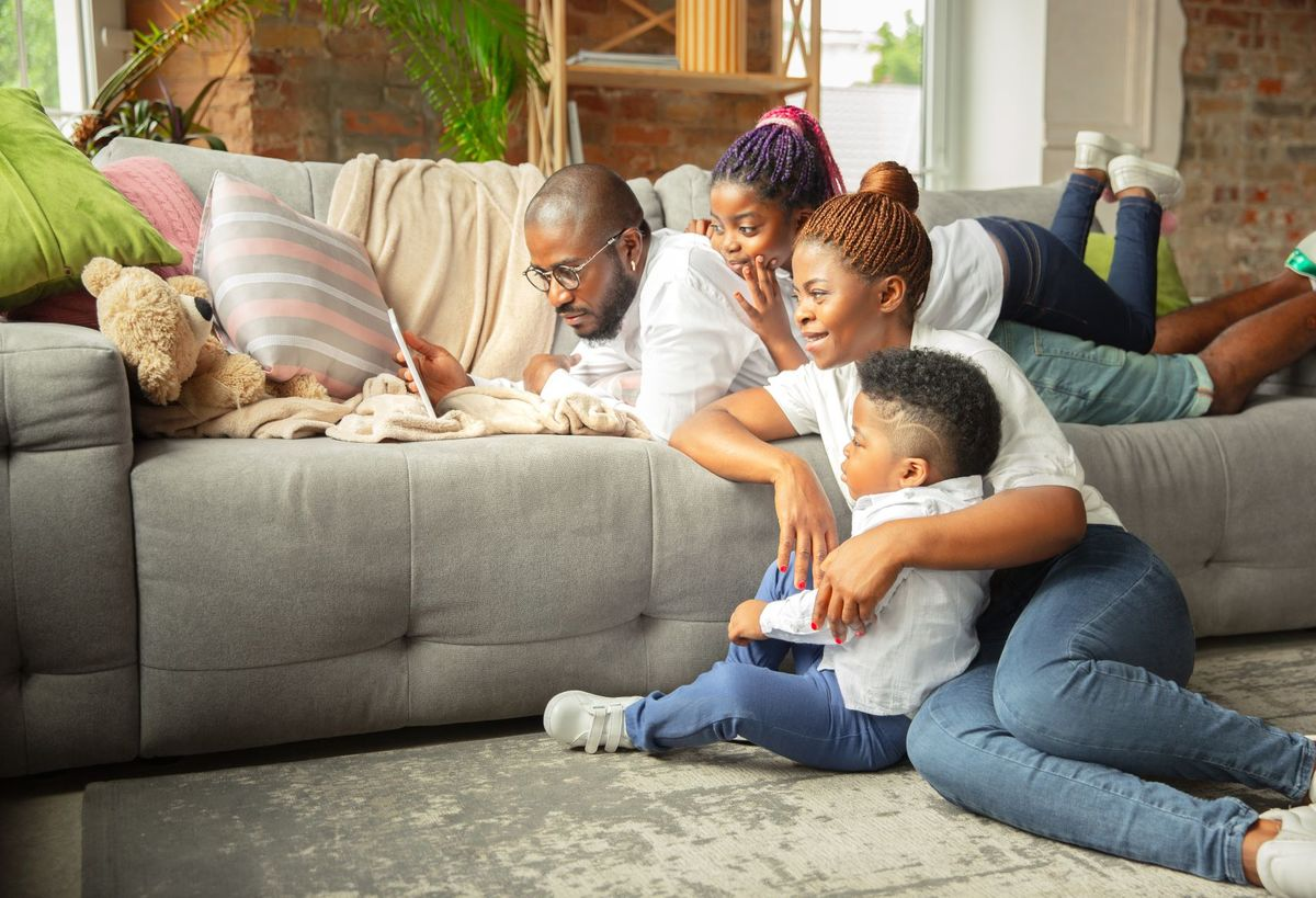 Young cheerful family during quarantine insulation spending time together home