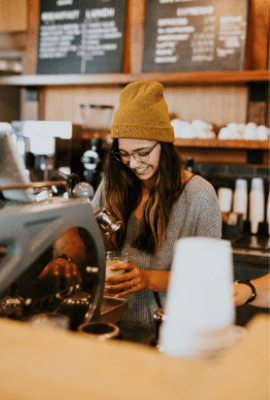 Waitress pouring a specialty coffee
