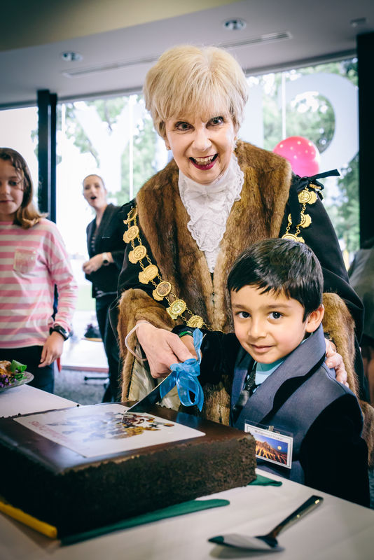 Muhammad Rizwan cuts the cake with Mayor Martin. The new citizen had double the reasons to celebrate with the ceremony coinciding with his 5th birthday.