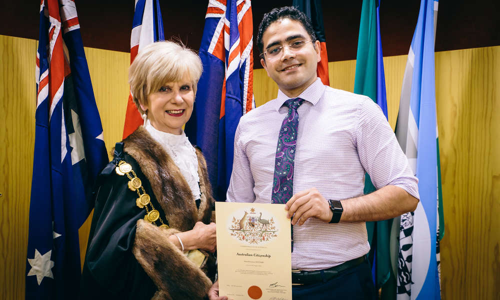 Amir Hatami is presented with his Australia Citizenship Certificate by Mayor Lynette Martin OAM at an Australian Citizenship Ceremony held at the City of Mount Gambier Council Chamber.