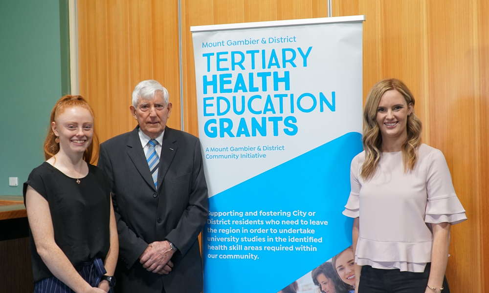 Previous grant recipients Cody Lewis (left) and Amelia Hancock with THEG chairman Ken Stafford (centre).