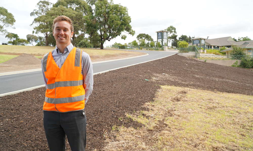 After. City of Mount Gambier Design Engineer Andrew Thompson stands alongside the completed roadway.