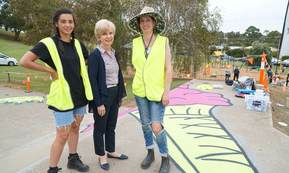 Artists Charlene Riley and April Hague with City of Mount Gambier Mayor Lynette Martin on site at AF Sutton Memorial Park as the mural at the skate park progresses.