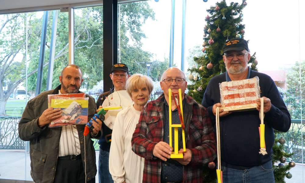 Mount Gambier Men's Shed members Peter Kukola, Ian Bond,  Mayor Martin, George Renzi and Peter Heness with examples of the wooden toys that will be handmade and donated to the appeal for families in need at Christmas.