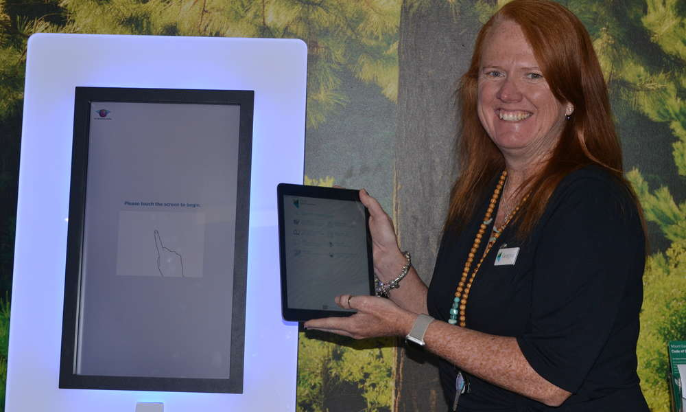 Library Manager Georgina Davison with the new Libraries SA app.