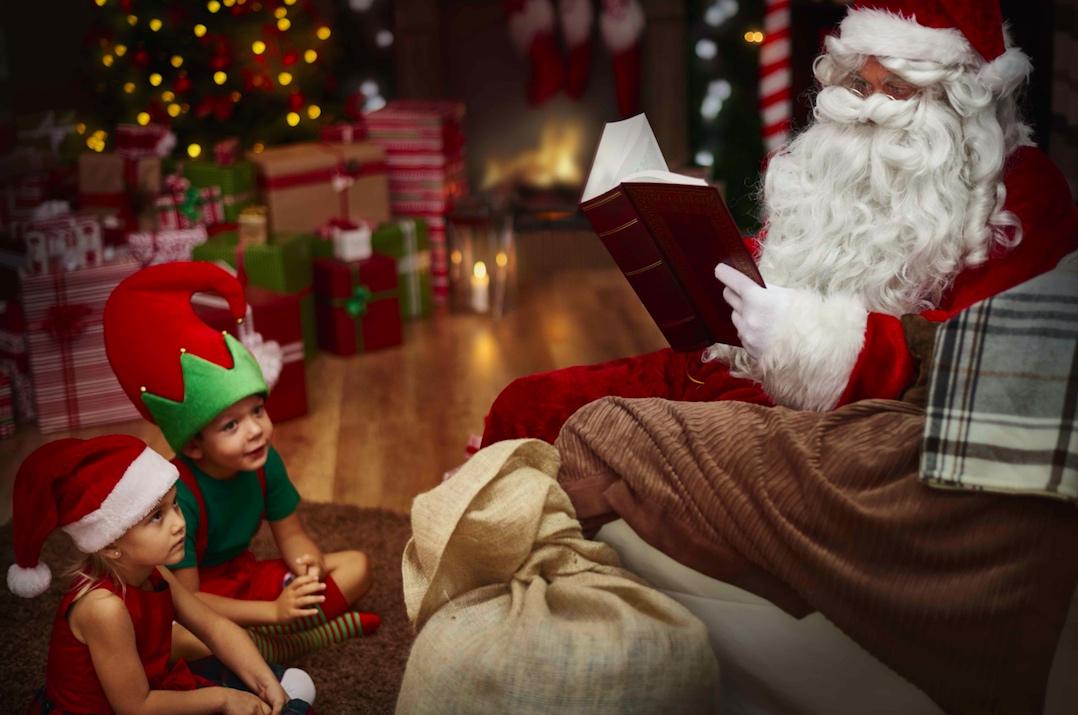 santa reading a story book