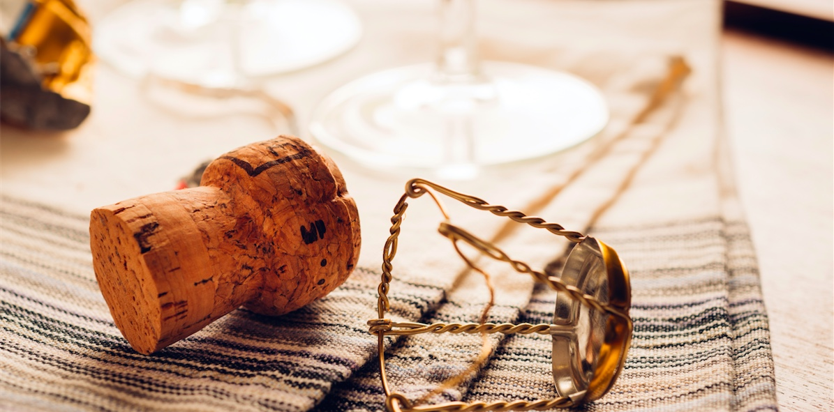 champagne cork lying on table