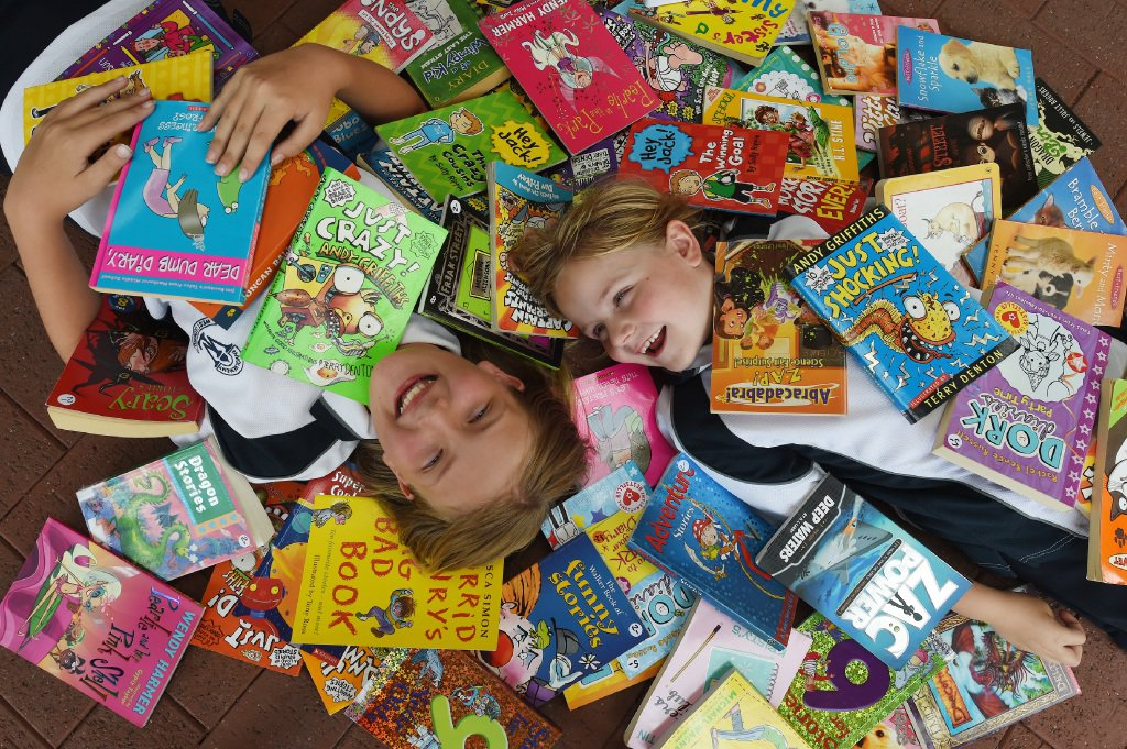 Sisters Olivia (10) and Sarah Boulton (7) are holding a book sale to raise funds to find a diabetes cure. Picture: Jon Hewson   d450055