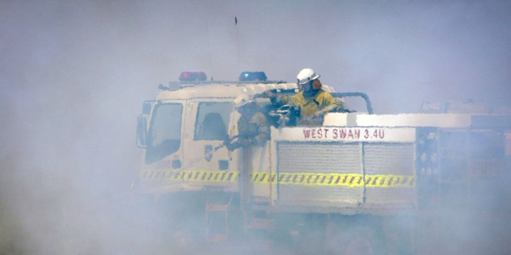 Firefighters fighting a blaze in Waroona in January