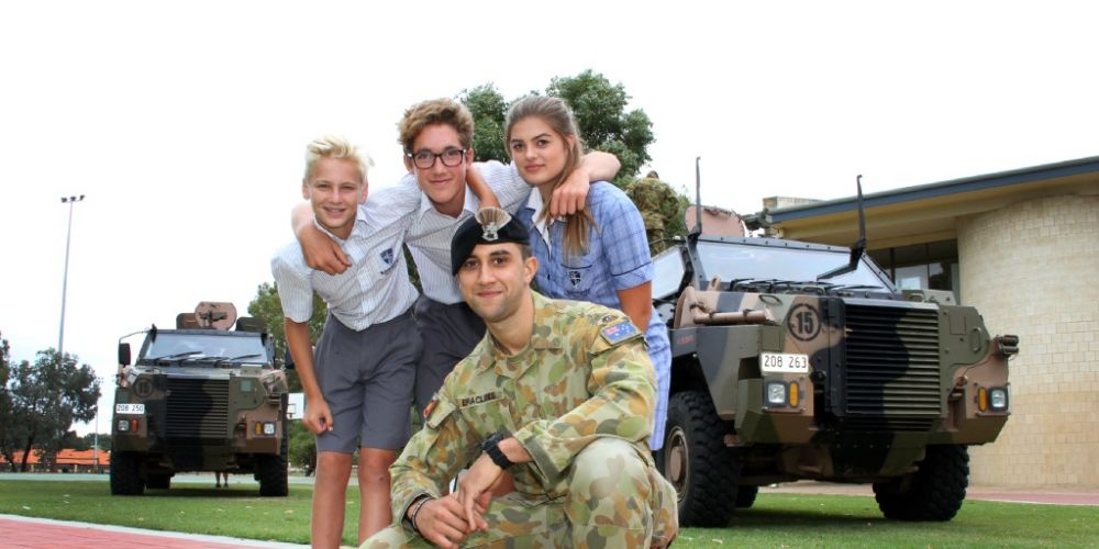 Kennedy Baptist College students Regan Bright, Dane Johnston and Mia Hughes with Lance Corporal Paulo Eraclides. Picture: Robin Kornet. d451659