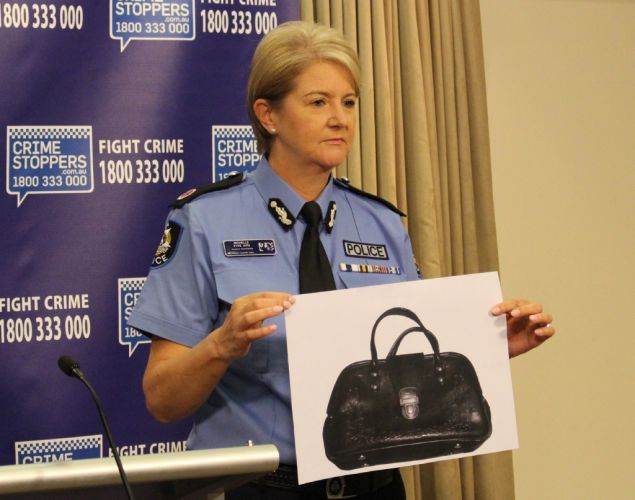 State Crime Assistant Commissioner Michelle Fyfe displays a photograph of a handbag stolen from Valeria Fermendjin's Melville home.