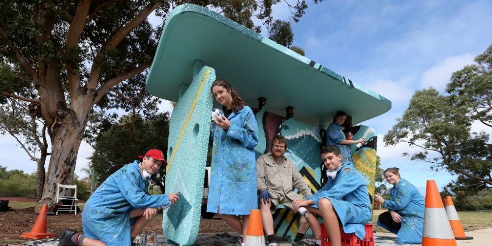 Year 9 students Finn Jacobsen, Georgia Strother with Artist Dan Duggan and students Callum Phillips, Paige Thompson and Jessica Walford from Seton Catholic College have painted a Bus Shelter on Winteford Road in Samson. Picture: Matt Jelonek d451895