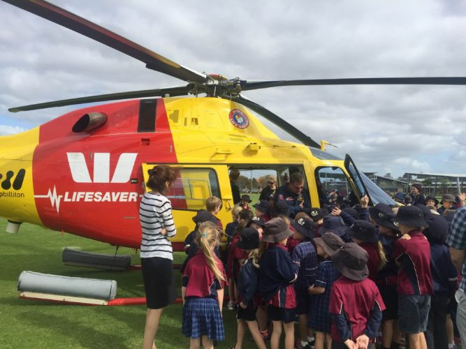 The Westpac Lifesaver Rescue Helicopter at Harmony Primary School on Tuesday.