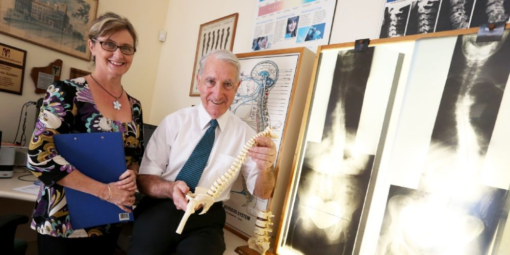 Chiropractor Michael McKibbin recently notched up 50 years in the profession - 23 of them alongside secretary Jayne Rogers.