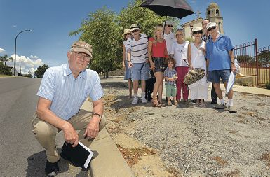 On the verge of despair: Clive Deverall (kneeling) with South Perth residents who say the unfinished kerb is an accident waiting to happen. Picture: Elle Borgward d395605