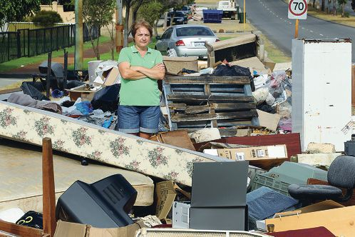 Grace Gilmore looks at a rubbish pile on her street. |Picture: Dominique Menegaldo www.communitypix.com.au d396355