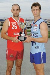 South Fremantle captain Ryan Cook and East Fremantle captain Mark McGough with the Sir Hughie Edwards Cup they will be playing for.