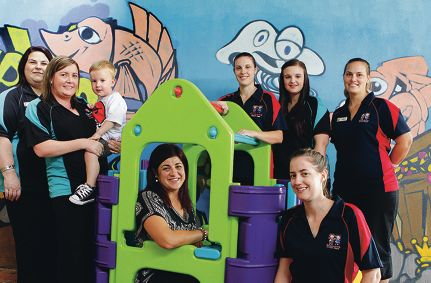 Gaby Valente (First Steps),Amy Smith and her son Cory (First Steps), Lisa Godwin (owner of Smileys Childcare), Bec Moyle (Smileys), Jessica Blackwood (First Steps), Fiona Millar (Smileys) and (front right) Emma Angus (Smileys) celebrate recognition by the WA Childcare Association of WA.
