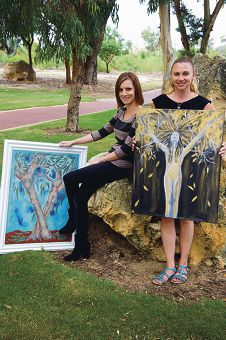 From Left: Jemma Caswell, Kathy Logie with the winning pieces from the past two Womens Healthworks Art Projects