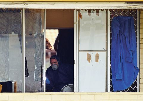 A forensic officer examines the Hubert Street property where a man was allegedly murdered. Picture: Matthew Poon www.communitypix.com.au d400340