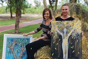 Jemma Caswell and Kathy Logie with the winning pieces from the past two Womens Healthworks Art Projects Picture: Emma Reeves d399428