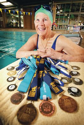 Pat Greysmith showing off some of her swimming medals. Picture: Daniel Wilkinsd285908