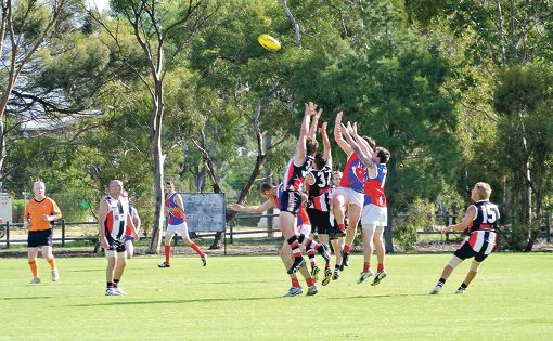 Action from the Bullsbrook Saints and Forrestfield Rhinos clash in Sunday's Hills Football Association fixture.