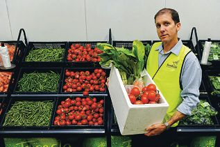 Foodbank partnership manager David Warren with a delivery of fresh fruit and vegetables. Picture: Marcus Whissonwww.communitypix.com.au d401951