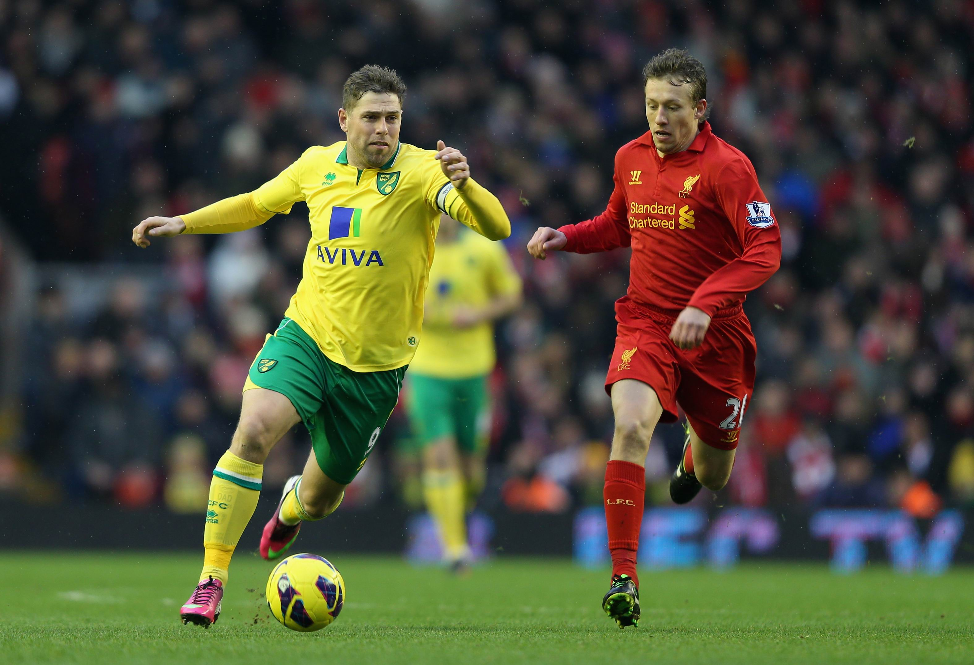 Grant Holt in attack for Norwich City against Liverpool during the 2012-13 season.